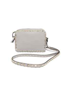 ROCKSTUD EMBOSSED CROSS BODY BAG